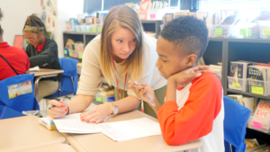 KIPP DC AIM's Ashleigh Rose helps a student